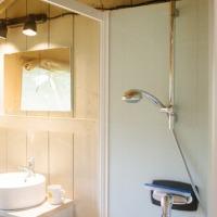 Safaritent met eigen sanitair Camping De Rammelbeek